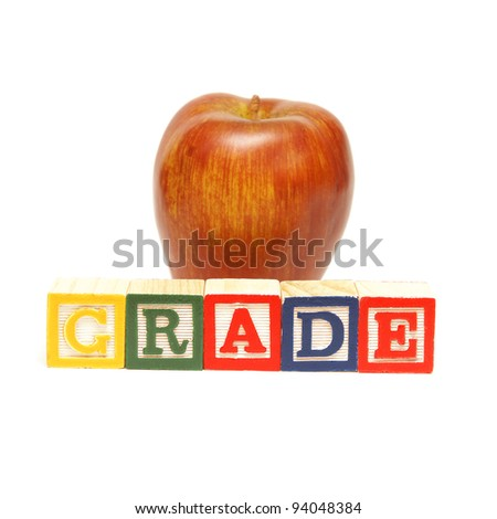 The spelling of the word grade using alphabet blocks.