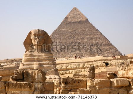 The Sphinx and the great Pyramid at Giza in Egypt. - stock photo