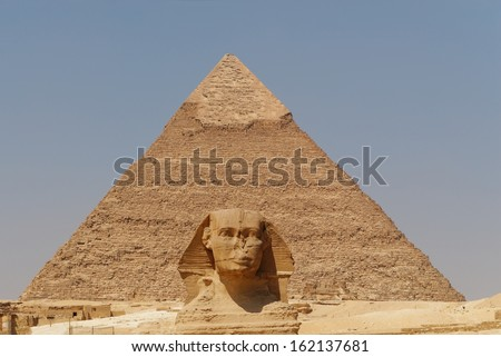 The Sphinx and the great Pyramid, Giza, Egypt - stock photo