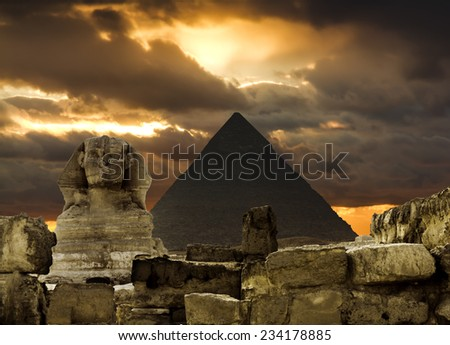 The Sphinx and the pyramid of Cheops in Giza in the background of a sky, Cairo, Giza - stock photo