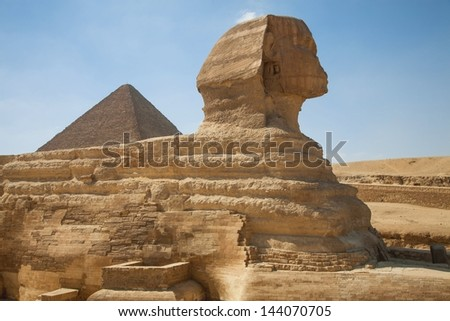 The Sphinx with the Great Pyramid in the background, Giza, Egypt - stock photo