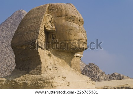 The Sphinx with the Great Pyramid in the background, Giza, Egypt. - stock photo