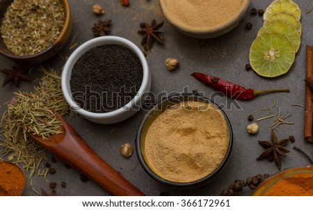 The spice and herb on stone background - stock photo