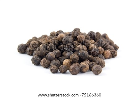 the spice black peppercorns in a pile isolated on white - stock photo