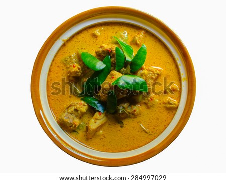 The spicy curry with chicken on white background. - stock photo