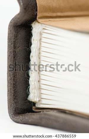 the spine of the book close-up on a light background - stock photo