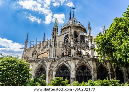 The spire and east side of Cathedral Notre Dame de Paris - a most famous Gothic, Roman Catholic cathedral (1163 - 1345) on the eastern half of the Cite Island. - stock photo