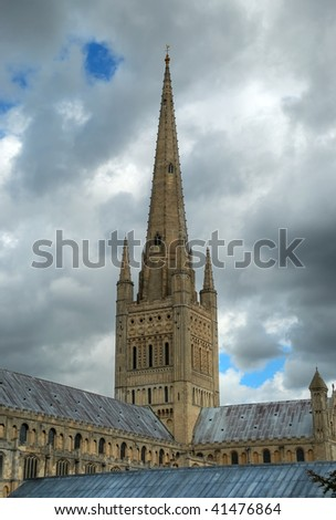 The spire and part of the roof of Norwich Cathedral in East Anglia, Britain. - stock photo