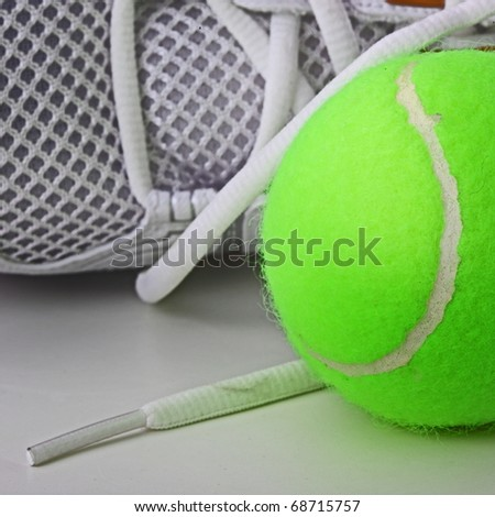 The sport concept. The closeup of sneakers and tennis ball. - stock photo