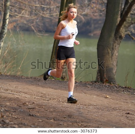 The sports girl runs in park