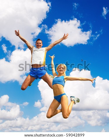 The sportsmans in a jump against the sky - stock photo