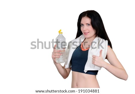 The sportswoman with a towel and mineral water on a white background - stock photo
