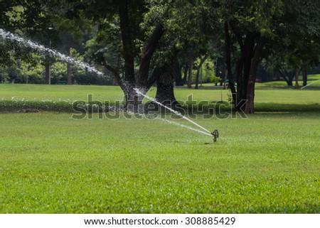 the sprinkler in garden - stock photo
