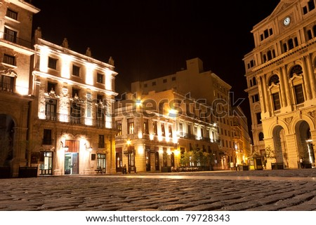 The square of San Francisco in the colonial neighborhood of Old Havana illuminated at night - stock photo