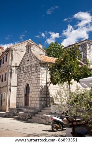 the square with chapel in city Omisalj - Croatia - Croatia - stock photo