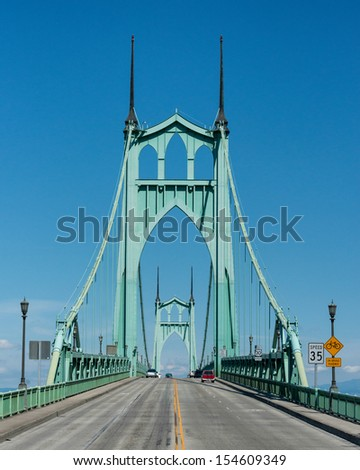 The St. Johns Bridge is a steel suspension bridge that spans the Willamette River in Portland, Oregon - stock photo