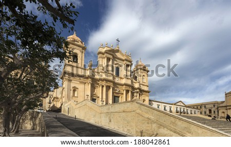 The St. Nicholas Duomo with blue and cloudy sky. - stock photo
