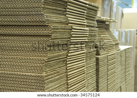 The stack of cardboard  (on a factory)