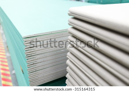 The stack of gypsum board preparing for construction - stock photo
