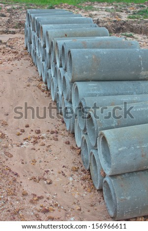 the Stacked concrete drainage pipes on the ground - stock photo