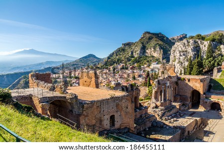 The stage of Taormina's Greek Theater with the Etna and Castelmola in the background, Taormina, Sicily - stock photo