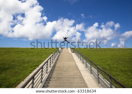 The stairs to the success.happy businessman  jumping over the top - stock photo