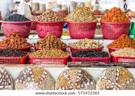 The stall with dried fruits at the Siab Dekhkhan Bazaar offers different raisins, apricots, prums and figs in Samarkand, Uzbekistan