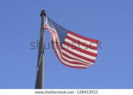 the Star-Spangled Banner in blue sky - stock photo