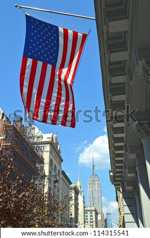 The Stars and Stripes or the american flag with Empire State Building in the background - stock photo