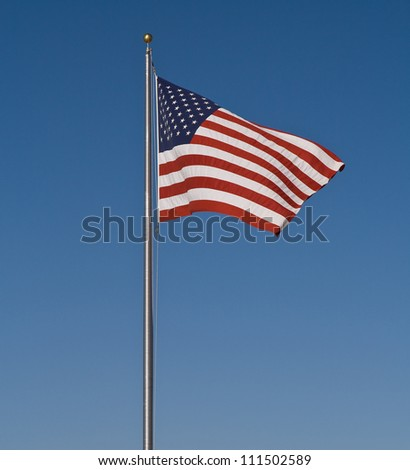 The Stars and Stripes set against a blue sky - stock photo