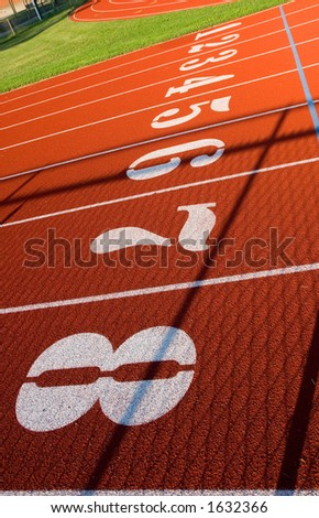 The start line for the 100 meter dash on the track. - stock photo