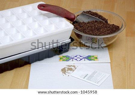The start of the gardening plan. Old trowel, germinating mix, plan, grow system. Focus = garden plan. 12MP camera. - stock photo