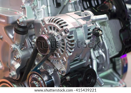The starter motor clased up with engine in background - stock photo
