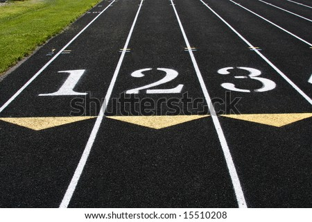 The starting line of the first 3 lanes of a track competition. - stock photo