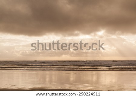 The starting of the sunset by the beach in Oregon coastline - stock photo