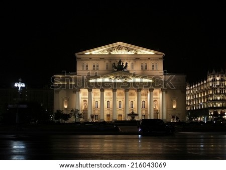 The State Academic Bolshoi Theater of Russia in Moscow, night view on long exposure.  Large historical white building with columns illuminated at night. - stock photo