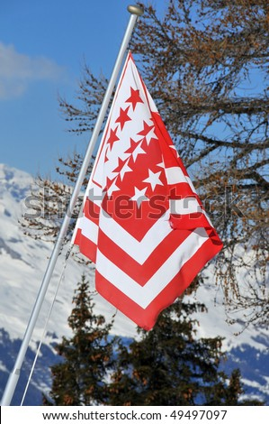 the state flag of the Valais in southern switzerland - stock photo