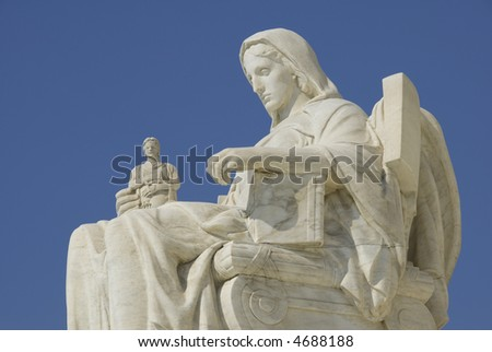 The statue called Contemplation of Justice at the entrance to the US Supreme Court in Washington, DC. - stock photo
