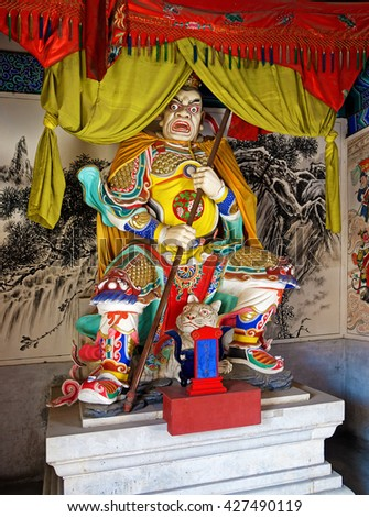The statue in the Zhenwu Temple, Beijing, China. The main god worshiped in the temple is Emperor Zhenwu, also called Emperor Xuanwu, who in ancient Chinese mythology is the god of the north. - stock photo