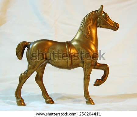 The statue of a horse made of brass - stock photo