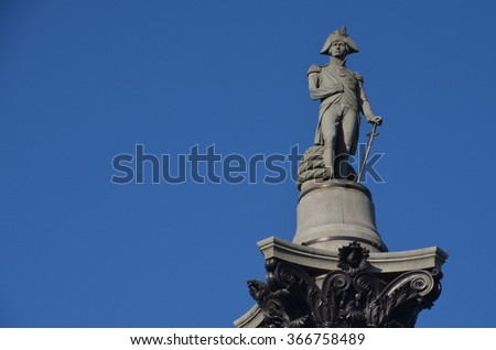 The statue of Admiral Nelson that sits on top of Nelson's Column in Trafalgar Square in London - stock photo