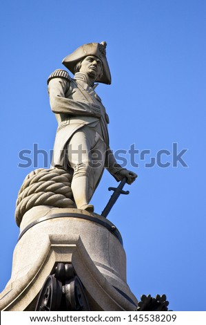 The statue of Admiral Nelson that sits ontop of Nelson's Column in London. - stock photo