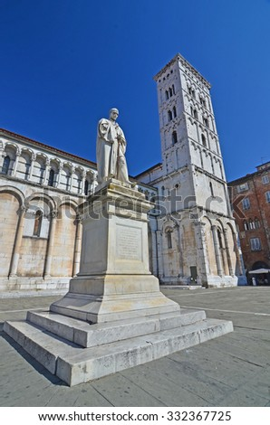 The statue of Francesco Burlamacchi, the first martyr of Italian unity in front of the St Michele church in Lucca, Italy - stock photo