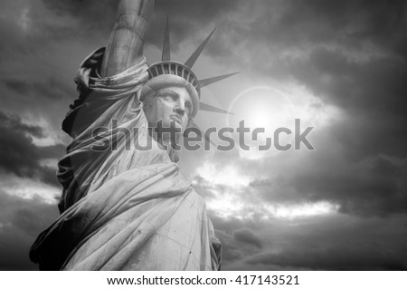 The Statue of Liberty and dramatic stormy clouds, New York, USA - stock photo