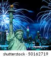 The Statue of Liberty and holiday fireworks - stock photo
