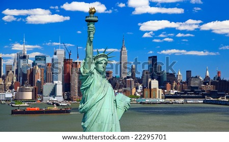 The Statue of Liberty and Manhattan Midtown Skyline USA - stock photo