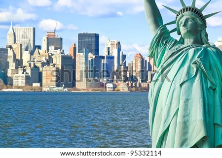 The Statue of Liberty and Manhattan New York City Skyline - stock photo