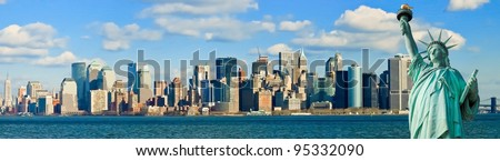 The Statue of Liberty and Manhattan New York City Skyline panorama - stock photo