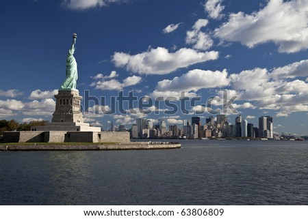 The Statue of Liberty and New York City Downtown - stock photo