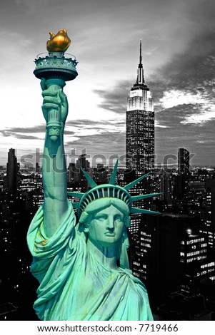 The Statue of Liberty and New York City skyline at dark - stock photo